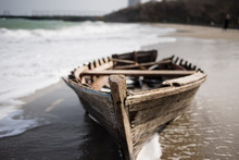 Wooden Boat Is Wet On The Seashore