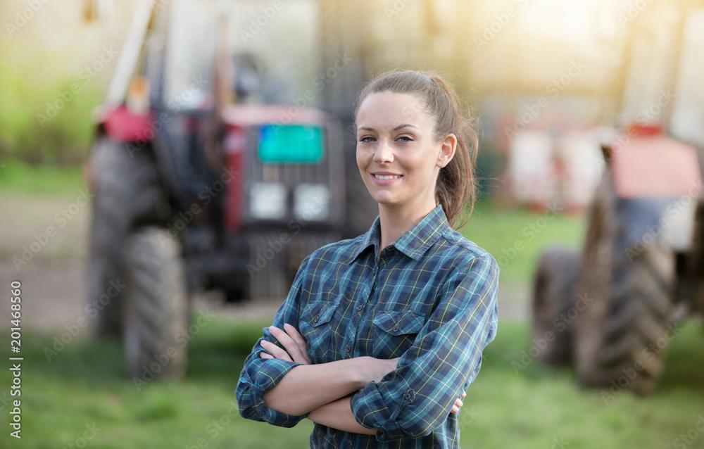 Fototapety, obrazy: Farmer woman with tractors on farmland