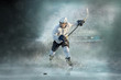 canvas print picture - Caucassian ice hockey Players in dynamic action in a professiona