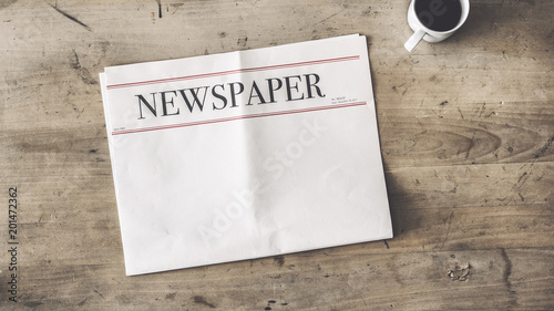 Newspaper and coffee on wooden background