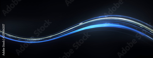 Fotografía  Colorful Light and stripes moving fast along a curved trajectory over dark background