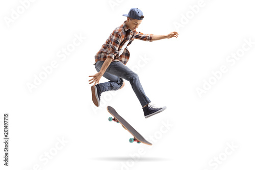 Teenage skater performing a trick with a skateboard