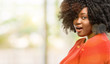 Beautiful african woman happy and surprised cheering expressing wow gesture, outdoor