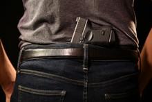 The Man Concealing Gun Behind ...