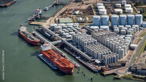 Montage in der Fensternische Rotterdam Aerial oil tankers storage silo tanks terminal.