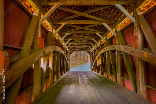 Indoor view of details of red covered bridge inside of the forest in Lancaster Canvas-taulu