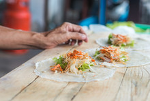 Women Making Spring Roll In Th...