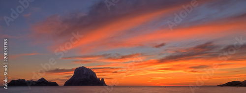 Poster Oranje eclat The sunset on the island of Es vedra, Ibiza