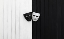 Black And White Theatrical Masks On A Black And White Wooden Table