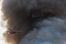 Heavy Helicopter Making A Water Drop On A Wildfire