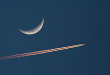 Airliner And Crescent Moon