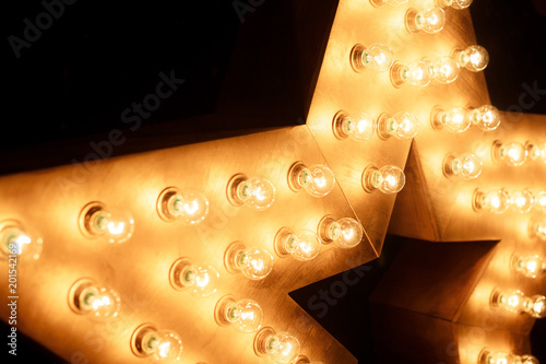 Photo  Decorative star with lamps on a background of wall. Modern grung