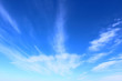 Blue sky and white cirrus clouds. Background. Landscape.