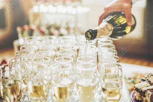 Fotografie, Obraz  waiter pouring champagne in stylish glasses at luxury wedding reception