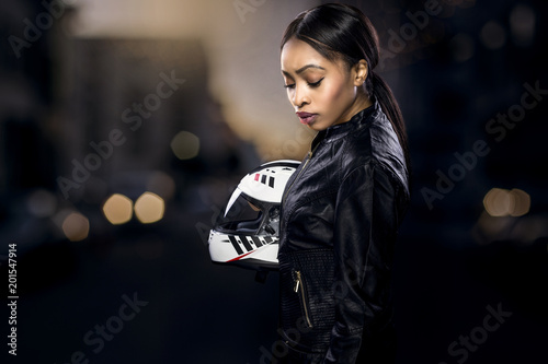 Recess Fitting F1 Black female motorcycle rider or race car driver wearing a racing helmet and leather jacket. Part of the gritty woman series, a competitive biker or racer getting ready for competition.