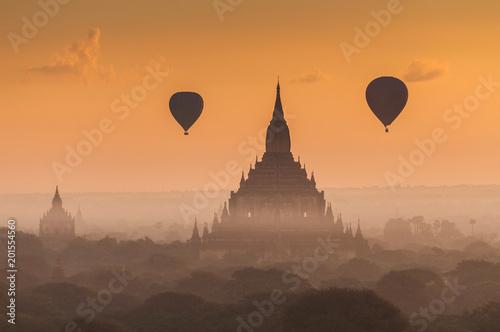 Fotobehang Zwavel geel Hot air balloon over plain of Bagan in misty morning, Myanmar.