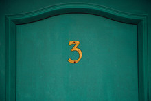 Number Three On Old Motel Door