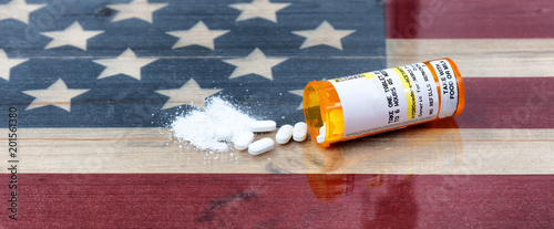 Fotografija  Open prescription bottle of crushed and whole opioid pain killer tablets on USA