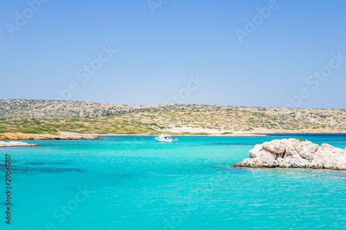 In de dag Groene koraal Beautiful sunny coast view to a small greek island bays and crystal clear blue water beach like paradise with some boats cruising or fishing, Arki, Tiganakia Beach, Leros, Dodecanese/ Greece