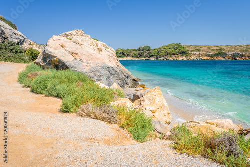 Printed kitchen splashbacks Coast Beautiful sunny coast view to a small greek village harbor white houses with crystal clear blue water beach cruising fishing some boats and hills background, Arki Island, Leros, Dodecanese, Greece