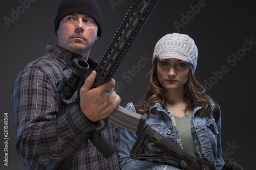 Father and daughter with rifles, ready to fight off the enemy. Poster