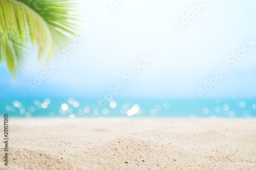 A seascape tropical beach. blur and bokeh light of seascape background, vintage color style. Focus on foreground.