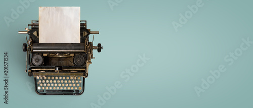 Tuinposter Retro Vintage typewriter header with old paper. retro machine technology - top view and creative flat lay design.