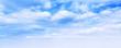 Wide blue sky background, cumulus clouds