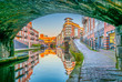 canvas print picture - Sunset view of brick buildings alongside a water channel in the central Birmingham, England