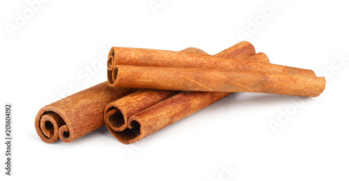 Leinwand Poster Cinnamon sticks isolated on white background