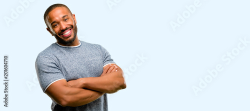 Canvas Print African american man with beard confident and happy with a big natural smile lau