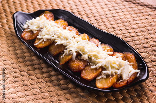 Fried plantain with cheese striped on top, South American food