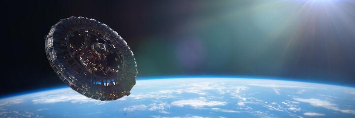Fototapeta gigantic space station in orbit of planet Earth