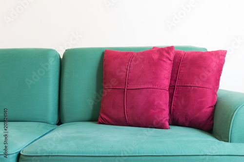 Green sofa and red backrest pillow in living room Wallpaper Mural