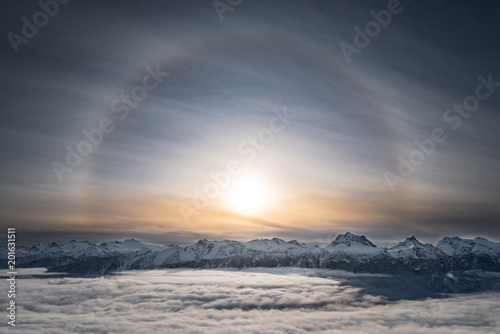 Fotografie, Obraz  A Halo around the sun over top of mt Begbie at Revelstoke mountain resort
