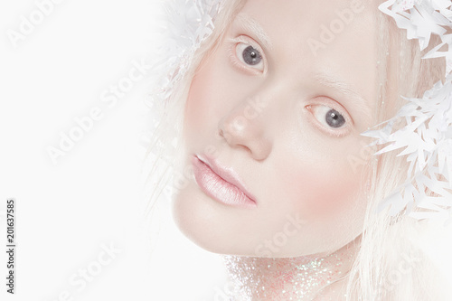 A very delicate portrait of an albino girl, a white background, snowflakes in her hair, sparkles, a magical winter image Wallpaper Mural