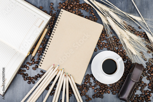 Modern table top with notepad and coffee - Buy this stock