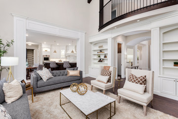 Beautiful living room interior with hardwood floors, view of kitchen and dining room in new luxury home