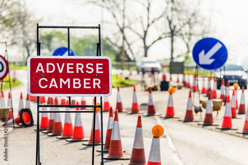 Adverse Camber Roadworks sign on UK motorway with cones Canvas Print