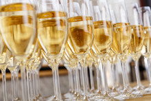 Rows Of Full Champagne Or Sparkling Wine Glasses.
