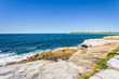 Sunny beautiful summer coast view to the blue Tasman Sea with wild wave water and rocky sharpe cliffs at shore perfect for fishing and hiking, swiming dangerous, Sydney, NSW, Maroubra Beach, Australia