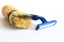 The Male Shaving Machine Is Blue. Shaving Brush. Brush For Shaving. Isolated On White Background. Close-up.