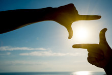 Fingers Gesturing Picture Frame On Sunrise Seaside
