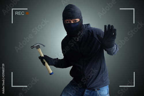 Fotomural Camera capture and record caught Masked thief with hammer at night