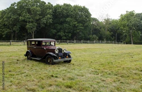 Fotografie, Obraz  Old vintage car in open field