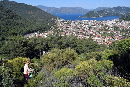 Foto op Plexiglas Khaki Woman and child.Backpack tourism.Campaign.Forest.Sea landscape.Icmeler.Marmaris.Turkey