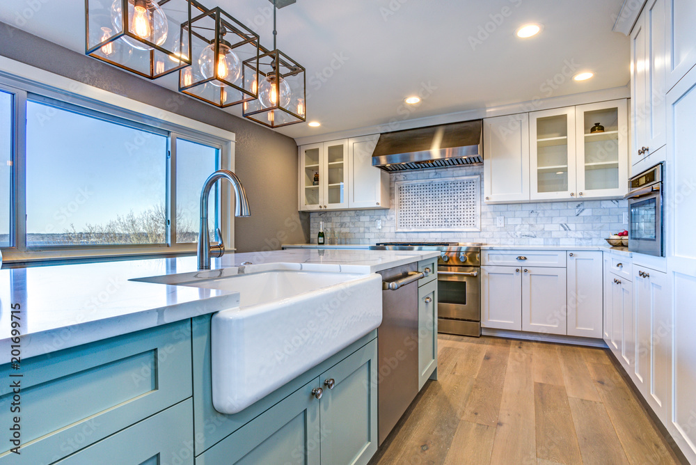Fototapety, obrazy: Beautiful kitchen room with green island and farm sink.