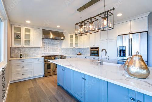 Beautiful white kitchen with large island.