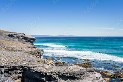 Foto op Canvas Cathedral Cove Amazing view to stunning rocky sandy beach deep blue water of southern ocean antarctica on warm sunny day with blue sky after hiking on to South Cape Bay, South-West National Park, Tasmania, Australia