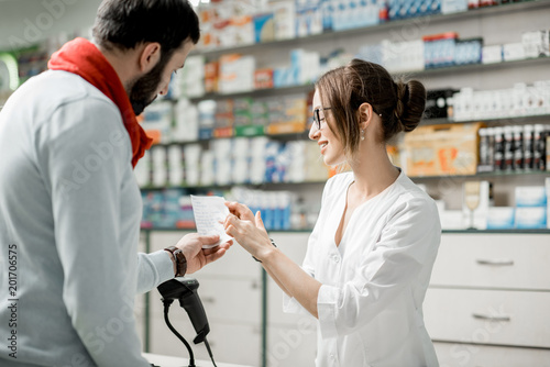 Photo sur Toile Pharmacie Buying medications in the pharmacy